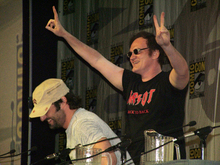 Quentin Tarantino (standing) and Robert Rodriguez (sitting) at Comic-Con International 2006